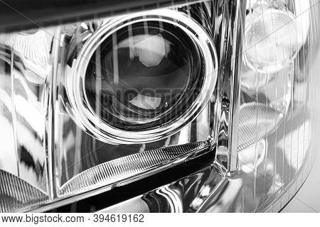 Car Headlight At Close Range. New Car Headlight.