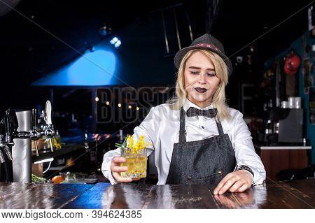 Focused Girl Bartending Creates A Cocktail At Bar
