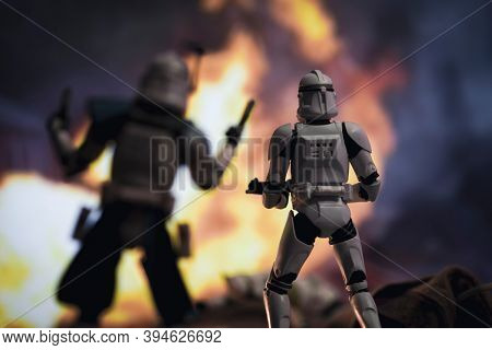 NOV 11 2020: Scene from Star Wars The Clone Wars with clone Captain Rex and troopers in battle - Hasbro action figures - Focus on trooper