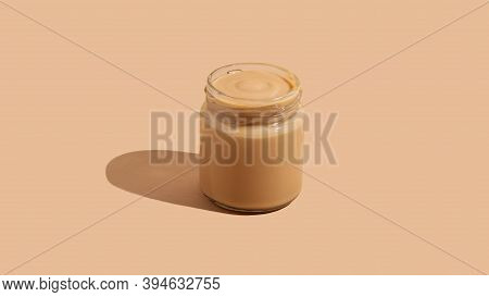 Yogurt Pudding Dessert In Glass Jar On Beige Background With Copy Space. Minimalism Conceptual Food