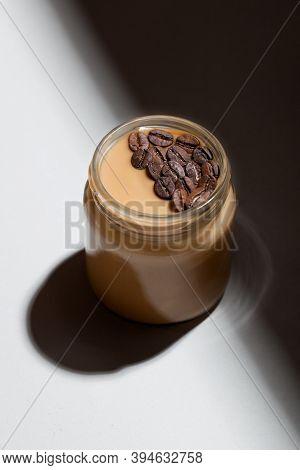 Coffee-flavored Yogurt Pudding Dessert In Glass Jar On White Background. Healthy Lifestyle, Superfoo