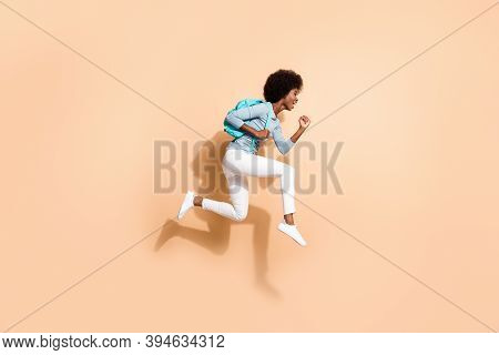 Photo Portrait Of Black Skinned Woman Hurrying Running Jumping Up With Blue Rucksack Isolated On Pas