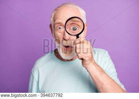 Close-up Portrait Of Shocked Funny Grey Beard Hair Pensioner Watching Through Loupe Isolated Over Pu