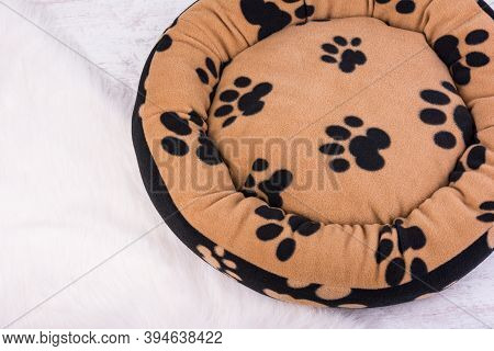 Pet's Paw Print On A Soft And Fluffy Dog's Bed On White Background.