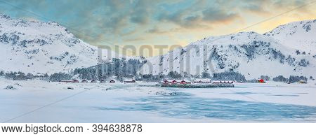 Winter Scene With Traditional Norwegian Red Wooden Houses On The Shore Of Rolvsfjord In Valberg On V