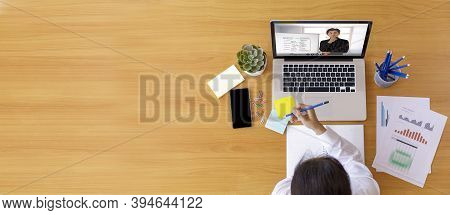 Top View Businessman And Businesswoman Analysis Financial Chart With Videoconference Online Meeting.