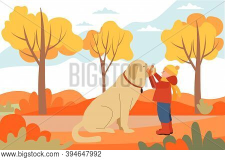 A Little Boy And A Companion With A Big Fluffy Brown Dog. Walking Along The Autumn Street, Forest.