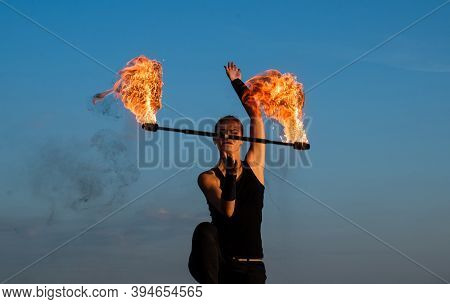 Its All About Sparkles. Sexy Woman Twirl Fire Batons. Female Fire Performer On Blue Sky. Woman Fakir