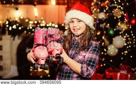 Merry Christmas And Happy New Year. Elf Child With Roller Skates. Holiday Gift. Little Girl In Red H