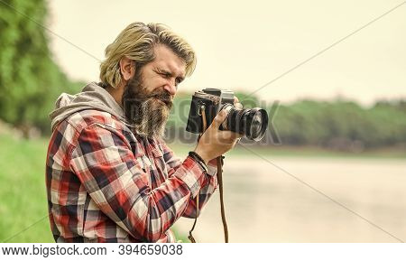 Masterpiece Shot. Man Bearded Hipster Photographer Hold Vintage Camera. Photographer Amateur Photogr