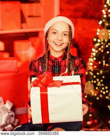 Kindness Concept. Small Cute Girl With Gift Box Near Christmas Tree. Winter Present. Present Concept