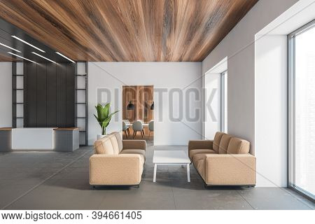 Wooden And White Office Hall With Reception Desk, Waiting Room With Brown Sofas And White Table On B