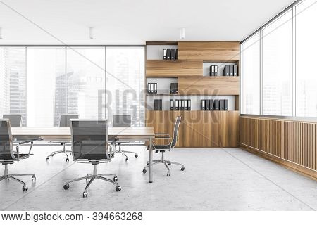 Office Meeting Room In Business Centre, Wooden Bookshelf With Black Folders. Wooden And Grey Design