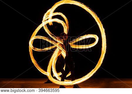 The Power To Manipulate Heat And Fire. Couple Of Dancers Manipulate Burning Pois. Fire Performance.