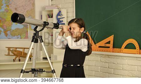 School Girl Looking Through Telescope. Little Girl Using Telescope. Telescope On Tripod. School Subj
