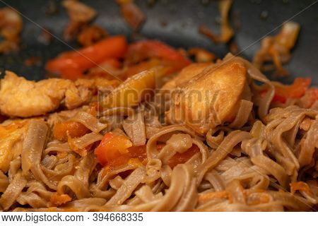 Wok With Buckwheat Noodles, Chicken In Soy Sauce And Vegetables. Appetizing Wok. Noodles With Vegeta