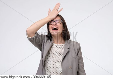 Mature Woman Regrets Wrong Doing, Keeps Hand On Forehead.