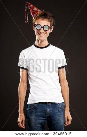 Nerd in funny glasses over black background