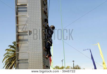 Boy climbing  a rock wall