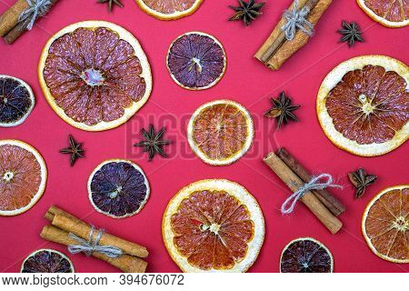Cinnamon Sticks, Star Anise And Dry Oranges And Lemons Top View. Spice Pattern For Mulled Wine. Dry