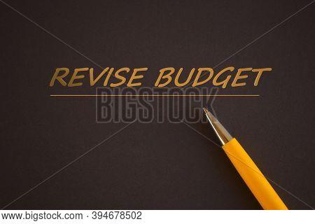 Revise Budget Text On Dark Background.orange Pen And Orange Text. Business Concept Photo Showcasing