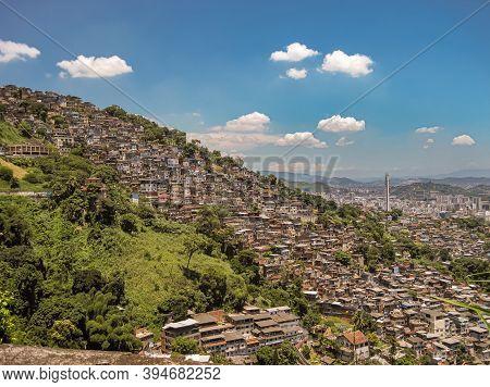 Rio De Janeiro, Brazil - December 24, 2008: Aerial View On Large Favela On Mountain Slope Under Blue