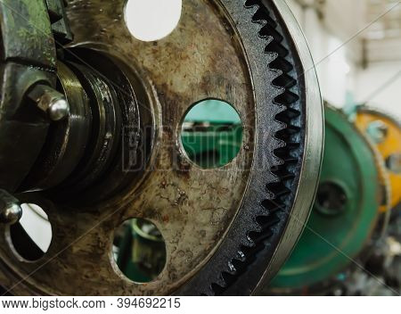 The Part Of The Rotating Lathe Old Machine In The Factory. Metalwork Lathes For The Manufacture Of M
