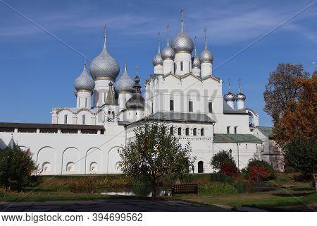 Historical Landscape. History And Religion. A Beautiful White Christian Church Against A Blue Sky In