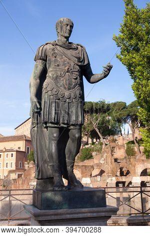Full length bronze statue of Roman emperor Gaius Julius Caesar at Via dei Fori Imperiali, Rome, Italy