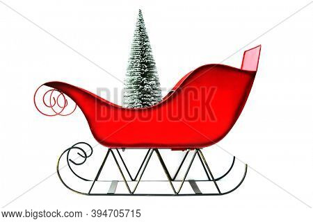 Christmas Sleigh. Red Santa Claus Sleigh. Isolated on white. Room for text. Christmas Sled with a Christmas Tree.