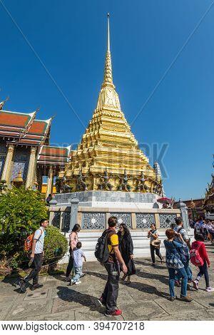 Bangkok, Thailand - December 7, 2019: Unidentified Tourists At Wat Phra Kaew In Bangkok, Thailand. W