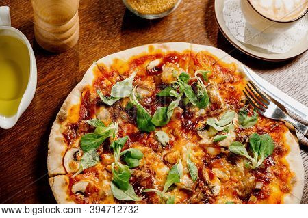 Mushroom Pizza With Addition Mozzarella Cheese And Herbs On A Wooden Table, Top View
