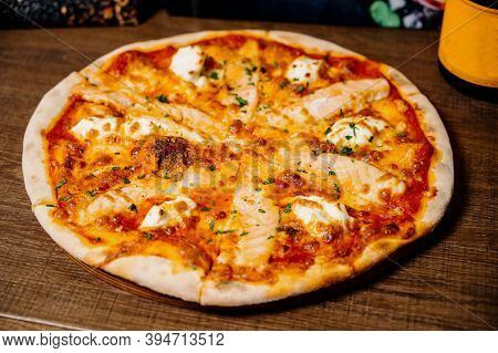 Pizza With Chicken, Mozzarella, Olives And Basil Top View With Copy Space