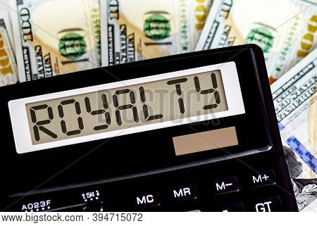 Calculator With Text Royalty On Dollars. Business, Finance Conceptual.