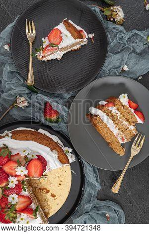 Strawberry Cake, Strawberry Sponge Cake With Fresh Strawberries And Sour Cream On A Dark Background