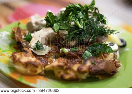 Baked Food On Plates, Pieces Of Turkey Meat And Potatoes With Parsley