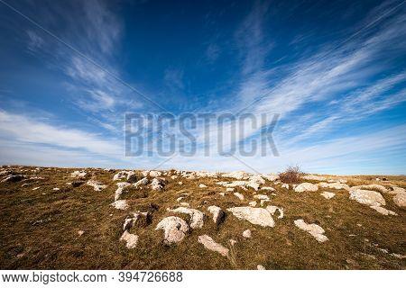 Landscape Of The Lessinia Plateau (altopiano Della Lessinia), In Autumn With Brown Meadow And Karst