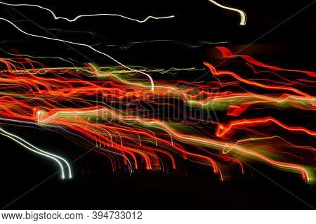 Bright Orange Neon Glowing Fast Moving Streams Of Light, Along A Trajectory. Fast Energy Flying Wave