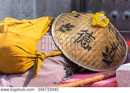 Beijing / China - October 5, 2015: Buddhist Pilgrim Praying At The Base Of The Stupa Of The Tooth Re