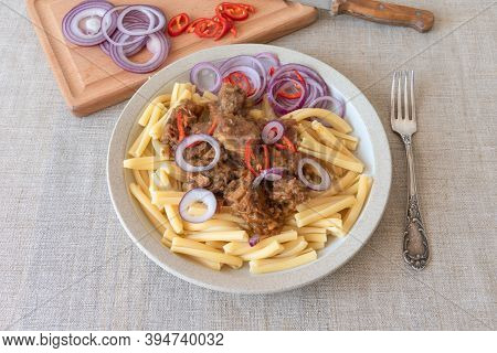 Pasta Genovese - Casarecce With Genovese-style Beef Sauce On Rustic Background