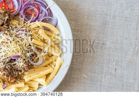 Pasta Genovese - Casarecce With Genovese-style Beef Sauce In A White Plate On A Rustic Background, C