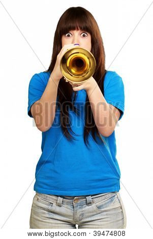 portrait of a teenager playing trumpet on white background