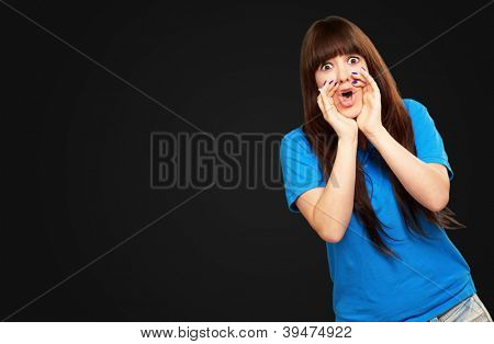 portrait of a teenager screaming on black background poster