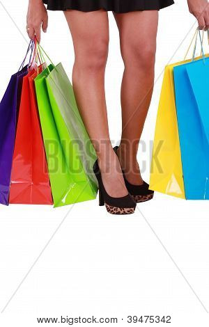 Beautiful Woman With A Lot Of Shopping Bags On White Background