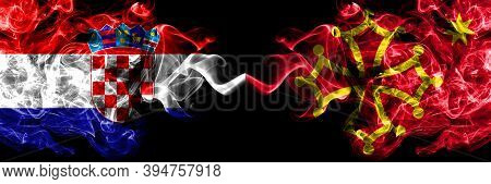 Croatia, Croatian Vs Occitania Smoky Mystic Flags Placed Side By Side. Thick Colored Silky Abstract