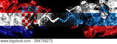 Croatia, Croatian Vs Slovenia, Slovenian Smoky Mystic Flags Placed Side By Side. Thick Colored Silky