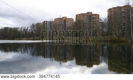 City Landscape. Forest And Houses Around Lake. Ripples On Water. Stormy Weather. Stormy Clouds. Sky,