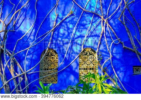 Bright Blue Wall And Complementary Yellow Windows In The Jardin Majorelle Concept Of Travel And Arch