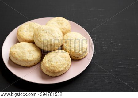 Homemade Flaky Buttermilk Biscuits On A Pink Plate On A Black Background, Side View. Copy Space.