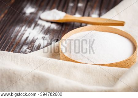 Baking Soda Powder On Wooden Rustic Background Background